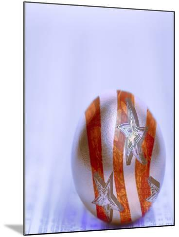 Stars and Stripes Golden Egg Resting on Financial Section of Newspaper--Mounted Photographic Print