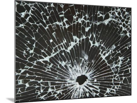 Close-up of a Hole in Cracked and Shattered Glass--Mounted Photographic Print