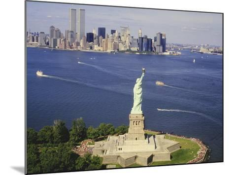 The Statue of Liberty and the New York Skyline--Mounted Photographic Print