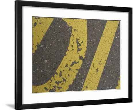 Close-up of Yellow Letters Painted on Gray Asphalt--Framed Art Print