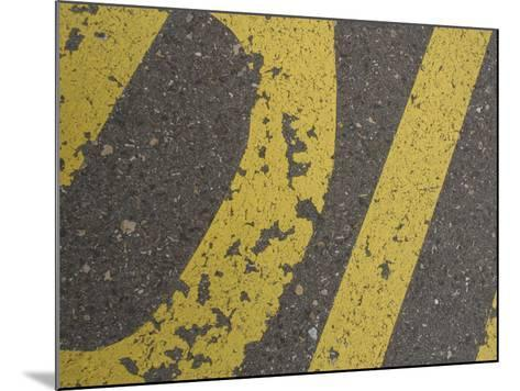 Close-up of Yellow Letters Painted on Gray Asphalt--Mounted Photographic Print