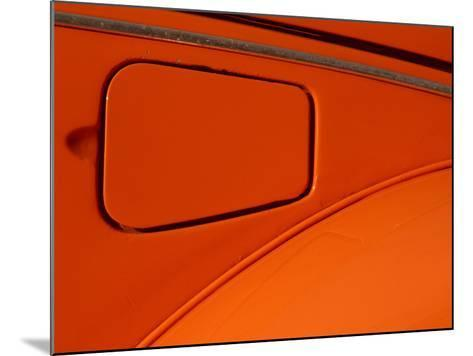 Close-up of the Gas Tank Lid on an Orange Car--Mounted Photographic Print