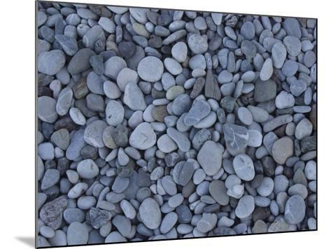 Close-up of Many Colorful Pebbles Under Clear Blue Water--Mounted Photographic Print