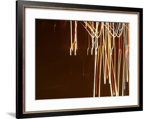 Colorful Streaks and Swirls of Light Against a Black Background--Framed Art Print