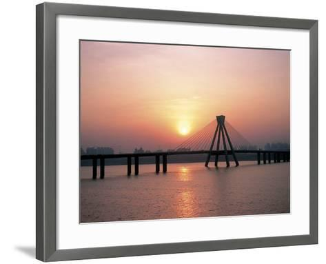 Bright Sunset with Suspension Bridge Over Water--Framed Art Print