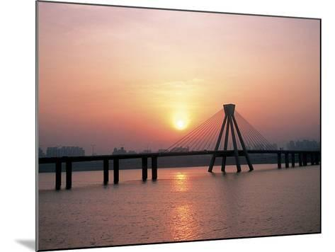 Bright Sunset with Suspension Bridge Over Water--Mounted Photographic Print