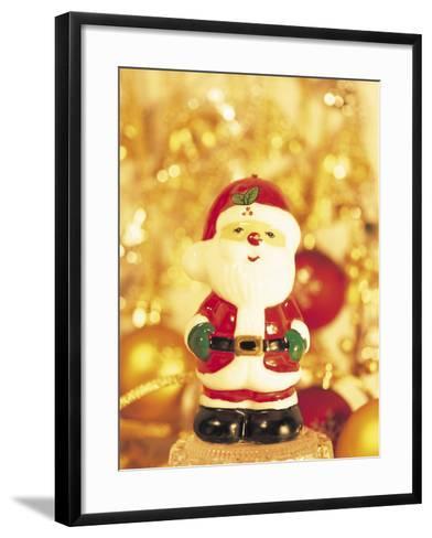 Close-up of a Santa Claus Figurine--Framed Art Print