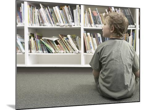 Little Boy Looking Rows of Books on Library Shelves--Mounted Photographic Print