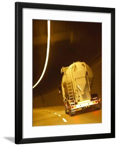 White Tanker Truck Driving Through Tunnel Lit with Electrical Lighting--Framed Art Print