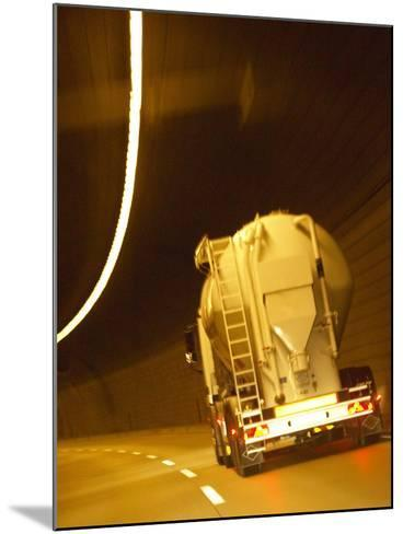 White Tanker Truck Driving Through Tunnel Lit with Electrical Lighting--Mounted Photographic Print