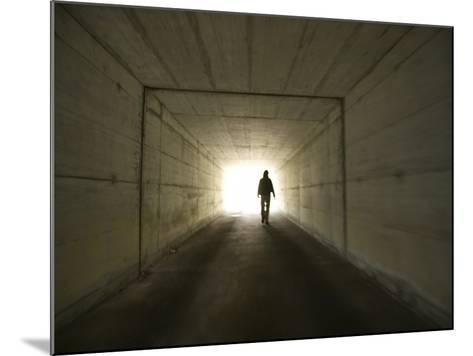 Person Walking Through Tunnel Towards Light--Mounted Photographic Print