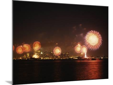 Fireworks Celebration with Manhattan Skyline and Statue of Liberty, Manhattan, New York--Mounted Photographic Print