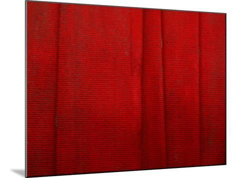 Bright Red Fire Hose Made of Tightly Woven Fabric and Folded into Layers--Mounted Photographic Print