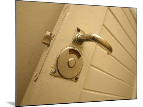 Brass Door Handle on White Painted Wood Wall--Mounted Photographic Print