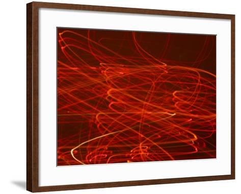 Abstract Motion Blur Pattern of Red Lights Swirling--Framed Art Print