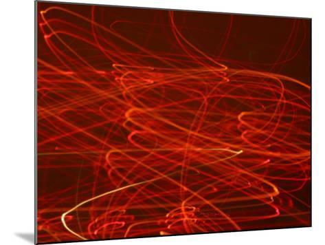 Abstract Motion Blur Pattern of Red Lights Swirling--Mounted Photographic Print