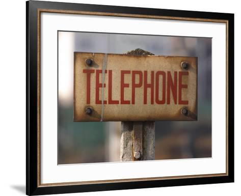 Close-Up of Singed Telephone Sign Outdoors--Framed Art Print
