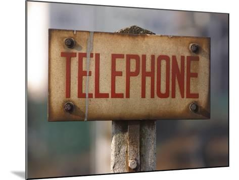 Close-Up of Singed Telephone Sign Outdoors--Mounted Photographic Print