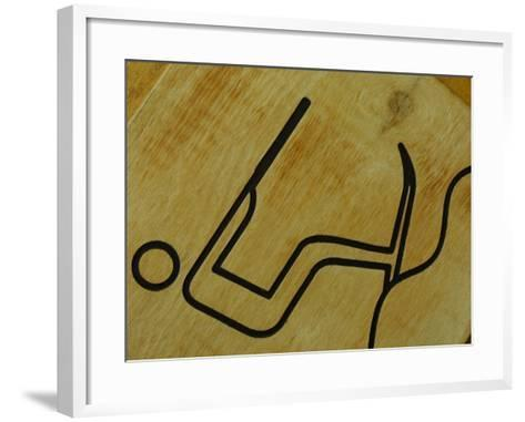 Close-Up of Wooden Tile with Water Skiing Figure--Framed Art Print