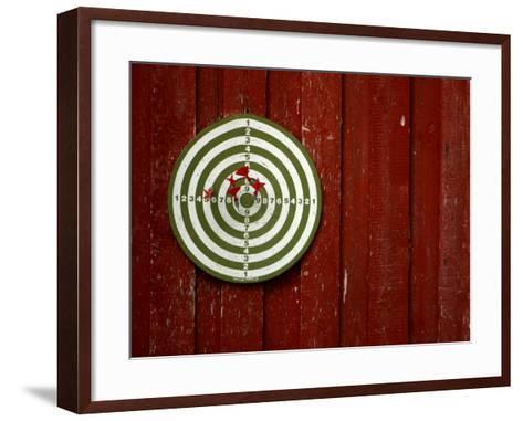 Old Dart Board Game Hanging on a Weathered Red Wall--Framed Art Print