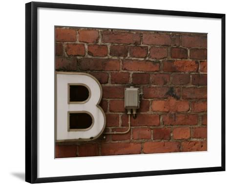 Florescent B Letter Light on Brick Wall--Framed Art Print