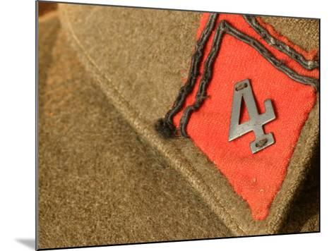 Patch with Number Sewn on Brown Fabric Background--Mounted Photographic Print