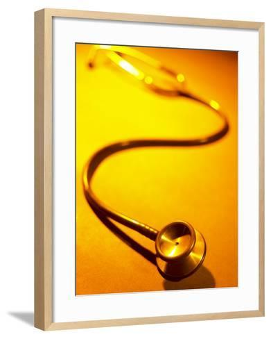 Selective Focus of a Stethoscope on Yellow Surface--Framed Art Print
