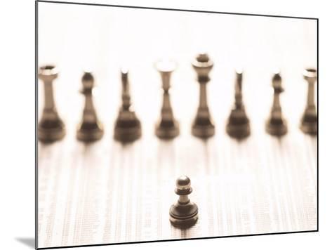 Selective Focus of Silver Pawn on Newspaper Stock Market Report with Line of Chess Pieces--Mounted Photographic Print