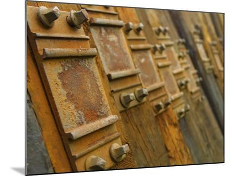 Close-Up of Rustic Metal Pieces Lined Up in a Organized Fashion--Mounted Photographic Print