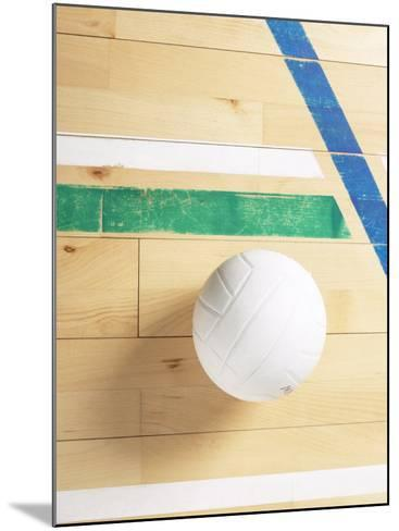 View of Volleyball on Wooden Gymnasium Floor--Mounted Photographic Print