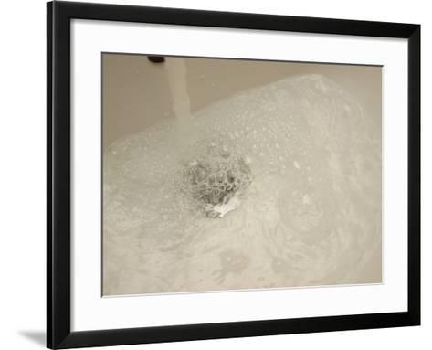 Water Rushing from Bathtub Faucet with Bubbles--Framed Art Print