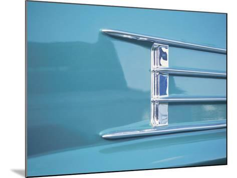 Detail of a Shiny Chrome Decoration on a Vintage Blue Car--Mounted Photographic Print