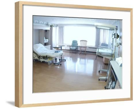 Hospital Bed, Chairs, and Medical Equipment Arranged in Empty Hospital Room--Framed Art Print