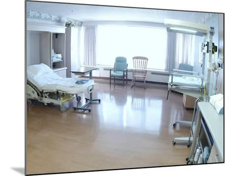 Hospital Bed, Chairs, and Medical Equipment Arranged in Empty Hospital Room--Mounted Photographic Print