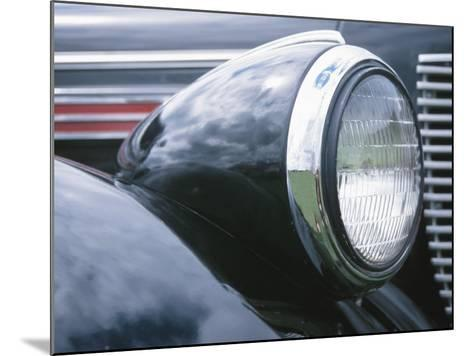 Reflective Chrome Headlight in Antique Black Car--Mounted Photographic Print