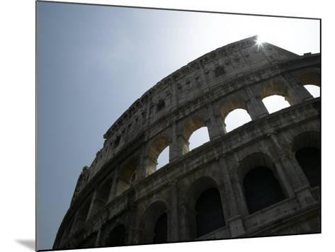 Sun Shining Through Ruins of the Coliseum, Rome, Italy--Mounted Photographic Print