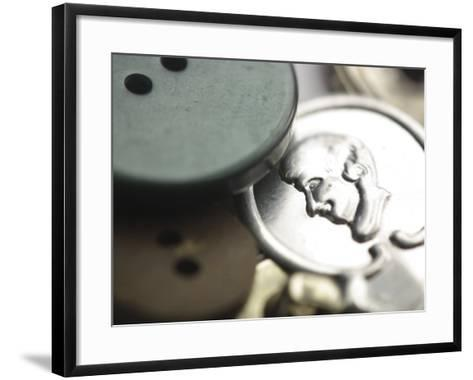 Close-Up on a Variety of Buttons and Needle Threader--Framed Art Print