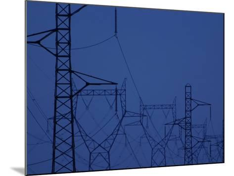 Silhouette of Towers with High Voltage Power Lines at Twilight--Mounted Photographic Print