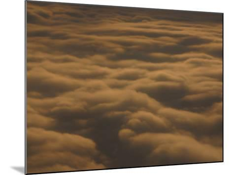 Fluffy Clouds in Vast Peaceful Sky at Dusk--Mounted Photographic Print