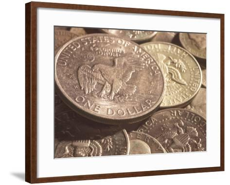 Close-Up of American Silver Dollar Coin with Eagle on its Face with Other Coins--Framed Art Print