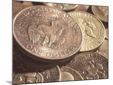 Close-Up of American Silver Dollar Coin with Eagle on its Face with Other Coins--Mounted Photographic Print
