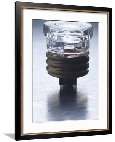 Studio Shot of Glass Electrical Fuse on Metal Surface--Framed Art Print