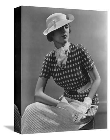 Vogue - January 1935 - Woman in Knitted Sportswear and White Hat-Lusha Nelson-Stretched Canvas Print