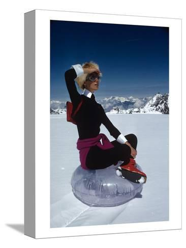 Vogue - November 1968 - Marisa Berenson Atop a Glacier-Arnaud de Rosnay-Stretched Canvas Print