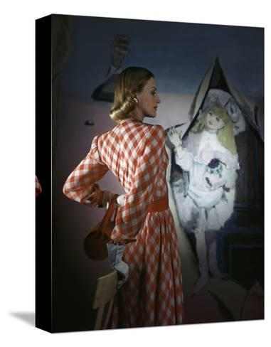 Model Standing before a Mural by Vertes Wearing a Red and White Lattice-Checked Rayon Crepe Dress--Stretched Canvas Print