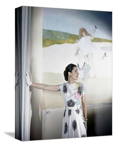 Model Standing before Mural by Vertes Wearing Floral Print on White Rayon Crepe Dress--Stretched Canvas Print