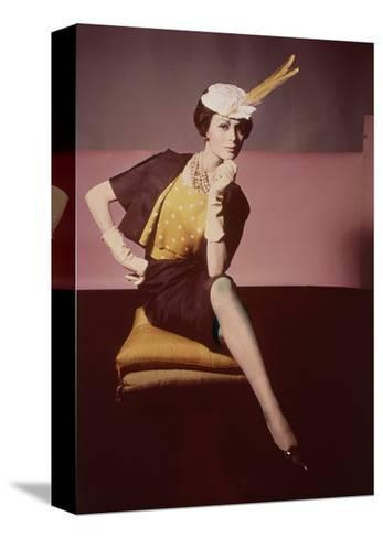 Duplicate of Model Seated on Yellow Cushion--Stretched Canvas Print