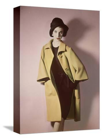 Duplicate of Model Wearing Bright Yellow Coat over Black Dress with Black Hat--Stretched Canvas Print