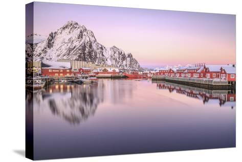 Pink Sunset over the Typical Red Houses Reflected in the Sea. Svollvaer, Lofoten Islands, Norway-ClickAlps-Stretched Canvas Print