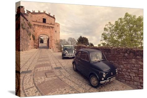Glimpse of Spello with Vintage Cars in the Foreground, Spello, Perugia District, Umbria, Italy-ClickAlps-Stretched Canvas Print